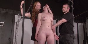 Tit whipping and frontal spanking of slave Caroline Pierce in double domination bdsm session in the dungeon with american submis