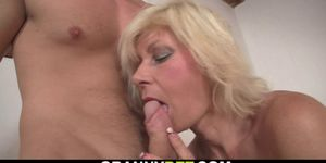 He doggy-fucks hot-looking blonde mature woman
