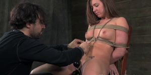 Tied up slave pleasured by vibrator