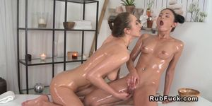 Masseuse rubs shaved pussy