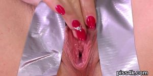 Fervid girl is geeting pissed on and bursts wet snatch
