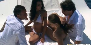 Two stunning babes anal orgy in a boat