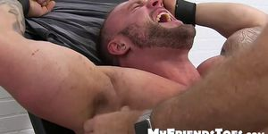 Huge muscular dude endures a feet tickling torment