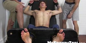 Handsome young man Logan restrained by deviant ticklers