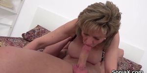 Adulterous English milf lady Sonia displays her gigantic hooters
