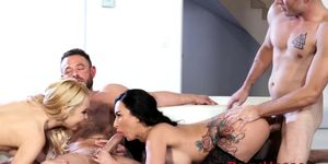 Lily Lane and Aaliyah Love trade spit while sucking dick