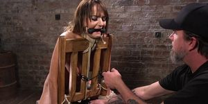 Whipped BDSM sub restrained for fingering