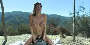 Busty machine MILF drilling pussy outdoors