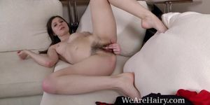 Slava Sanina strips naked on her white couch