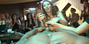 Wild party babes jerking stripper at party