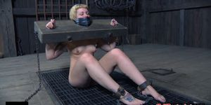 Restrained slave slapping with another sub
