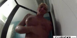 Hot big titty blonde takes a shower