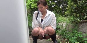 Asian hottie pissing outdoors