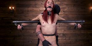 Gagged redhead sub pussy rubbed in dungeon