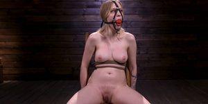 Gagged and blindfolded sub on hogtie