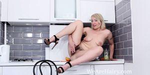 Luiza M strips naked and masturbates in a kitchen