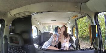 Busty redhead gets huge strap on in cab