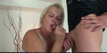 Two young dudes share very old blonde woman
