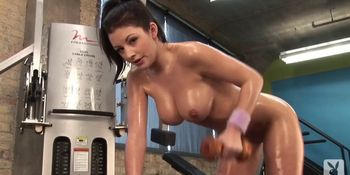 Naked woman exercising in the gym