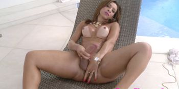 Latina tranny tugging her cock in the pool