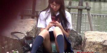 Unaware Japanese schoolgirls show panties to voyeur