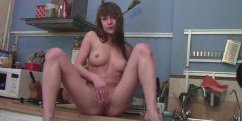 Brunette babe masturbates in the laundry room