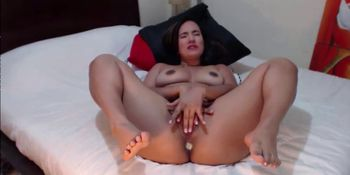 Sexy Latina gets squirting with butt plug