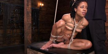 Restrained ebony submissive gets spanked