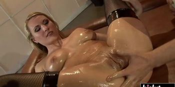 Oiled hottie gets her ass banged