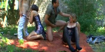 A mature and a babe fucked in the garden