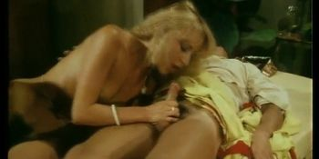 Vintage German babe rubbing dick at a party