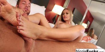 Pornstar Nicole Aniston gives a foot job to a big cock